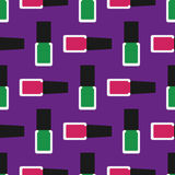 Nail polish seamless pattern 3. Green and crimson nail polishes or nail lacquers on a purple background Royalty Free Stock Images
