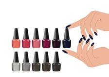 Nail polish sets. Woman's hands with nail polish sets Stock Image