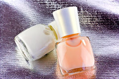 Nail polish on silver fabric Stock Photo