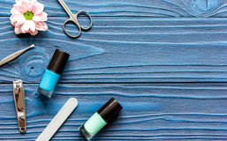 Nail polish and spa manicure set on dark wooden background. Top view stock images