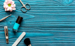 Nail polish and spa manicure set on dark wooden background. Top view royalty free stock photo