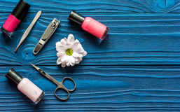 Nail polish and spa manicure set on dark wooden background. Top view stock photos