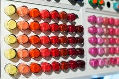 Nail polish on stand Stock Photos