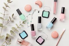 Pastel colors nail polish. Beauty blogger concept. Nail polish of various pastel colors and colorful candies. Mockup or Beauty blogger concept stock photos