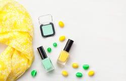 Pastel colors nail polish. Beauty blogger concept. Nail polish of various pastel colors and colorful candies. Mockup or Beauty blogger concept royalty free stock image