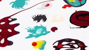 Nail polish (varnish) mixed multicolor blots rotating over white stock footage