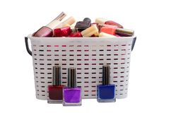 Nail Polish in a white basket royalty free stock image