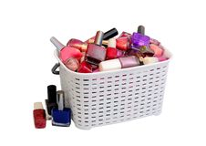 Nail Polish in a white basket royalty free stock photography