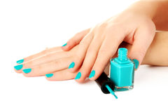 Nail polish. In the woman hand on a white background Stock Photo