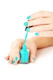 Nail polish in the woman hand Royalty Free Stock Photo