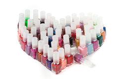 Nail polishes. The nail polishes of all colours exposed in the form of heart Stock Photos