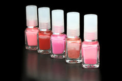 Nail polishes. Multicolor nail polishes on black background Royalty Free Stock Image