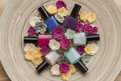 Nail polishes. Six colorful nail polishes, bird eye view Stock Photos