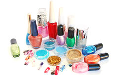 Nail polishes and  glitters. Nail polishes,glitters and nail figures isolated on white background Stock Photos