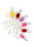 Nail polishes and jewels Royalty Free Stock Image