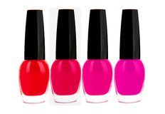 Nail polishes of red and pink color isolated on white Royalty Free Stock Image