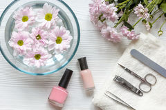 Nail polishes and spa on wooden background. Top view stock photos