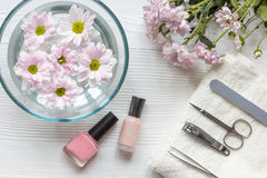 Nail polishes and spa on wooden background royalty free stock images