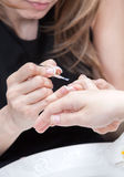 Nail polishing during manicure Stock Photo