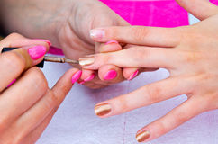 Nail polishing in manicure salon Stock Photography