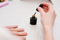 Nail primer during the procedure nail gel.Manicure arms.Good h. Nail primer during the procedure nail gel Stock Photography