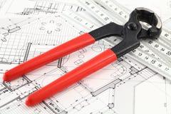 Nail puller, ruler & architectural plan Stock Image
