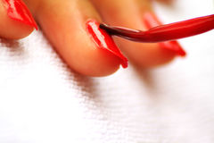 Close up of nail red paint manicured royalty free stock photo