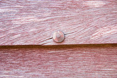 Nail on red wooden board Royalty Free Stock Photo
