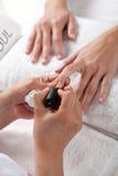 Nail salon. French manicure process Stock Image