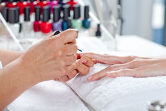 Nail salon. Manicure process. Stock Image