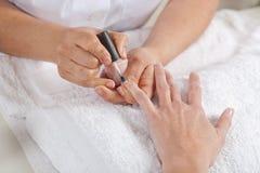 Nail salon. Manicure process. Stock Photos