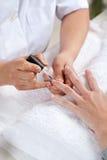 Nail salon. Manicure process. Royalty Free Stock Photo