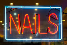 Nail salon neon sign background Stock Images