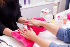 Nail saloon dry hands with towel after skin renewal bath Royalty Free Stock Photos