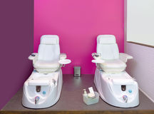 Nail saloon Pedicure chair spa furniture in pink wall Royalty Free Stock Photos