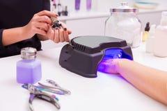 Nail saloon UV lap of quick dry nail polish Royalty Free Stock Photos