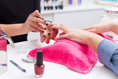 Nail saloon woman with hand manicure cuticle scraper pusher Stock Photography