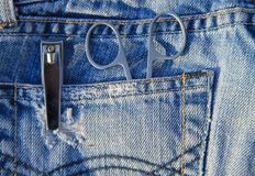Nail scissors and clippers in blue jeans pocket Stock Photography