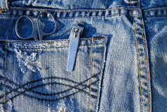 Nail scissors and clippers in blue jeans pocket Royalty Free Stock Photography