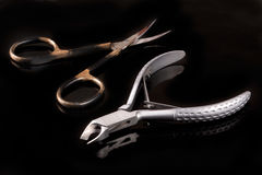 Nail scissors and clippers to remove the cuticle care products on black background Stock Image