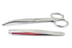 Nail scissors with  eyebrow tweezers Stock Image