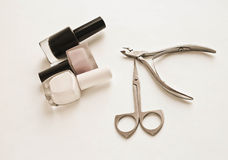 Nail scissors and tweezers on a white background stock images