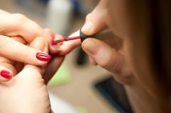 Finger care, cleaning in the beauty salon macro royalty free stock images
