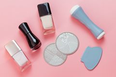 Nail stamping kit on pink background. stock image