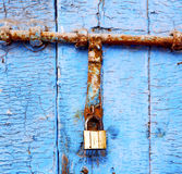 Nail stripped   in the b lue wood door and rusty Stock Photography
