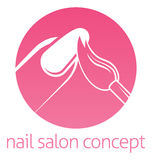 Nail Technician concept. Nail technician, nail bar or salon manicurist concept of a nail being painted with a brush Stock Photo