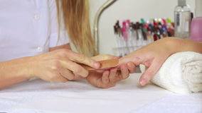 Nail technician filing customers nails stock video footage