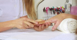 Nail technician filing customers nails stock video