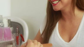 Nail technician filing smiling customers nails stock footage
