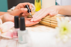 Nail technician giving customer a manicure Royalty Free Stock Photo